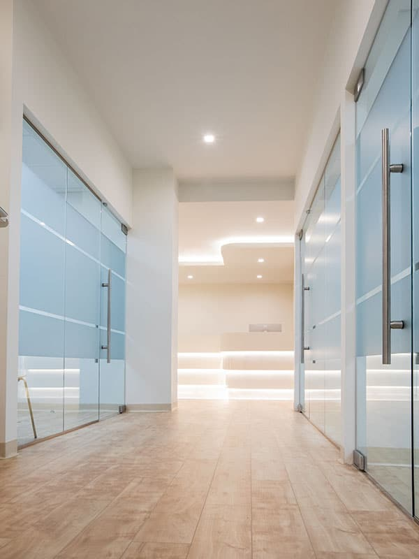 hallway with glass doors and walls
