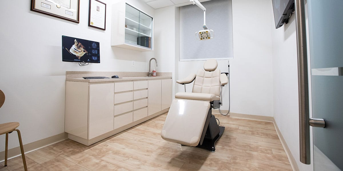dental exam room with beige chair